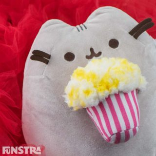 Pusheen plush enjoying an overflowing bucket of buttered popcorn. From the Pusheen Snackable collection, that features a cookie, ice cream, sushi, and more!