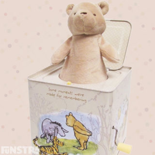 'Some moments were made for remembering.' A classic Winnie the Pooh jack-in-the-box toy featuring Pooh bear, Eeyore and Tigger.
