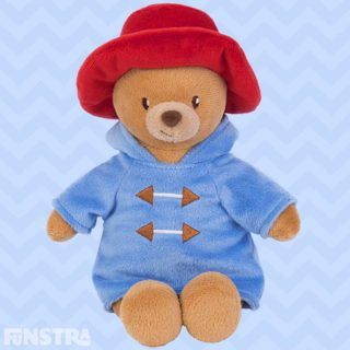 Adorable my first paddington bear plush soft toy for newborn babies made from soft velour of Michael Bond's timeless bear wearing his famous red hat and blue duffle coat with a hood and embroidered detailing.