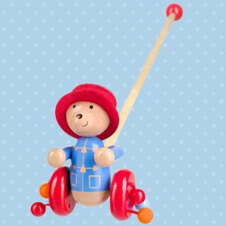 Join Paddington Bear on his many adventures and encourage those first steps with the perfect walking companion with a hand painted wooden push along toy from Orange Tree Toys.
