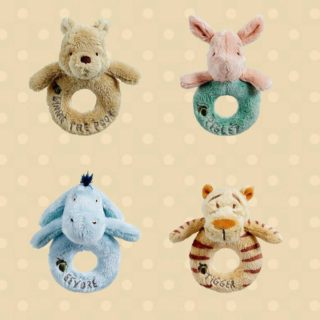Baby soft plush face of Winnie the Pooh bear, Piglet, Eeyore donkey and Tigger on a classic plush ring with jingle rattle.