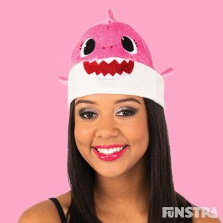 Anyone can dress up as Mummy Shark with this unisex hat that will fit most adults. The pink Mummy Shark plush beanie style hat features felt teeth and eyes with 3D mini fins attached at the sides and mini dorsal fin on top.