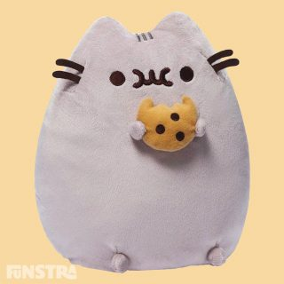 Bring home your very own super squishy and lovable Pusheen plushy — along with a soft sweet cookie! This classic standing pose plush version of Pusheen satisfies her sweet tooth with her chewing on a tasty-looking chocolate chip cookie.