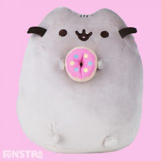 Pusheen satisfies her sweet tooth with a tasty-looking frosted donut. Pusheen is the snack-loving cat who loves to go on adventures with friends like Sloth, Stormy, Pip and Cheek in her popular webcomic with over 10 million social media fans!