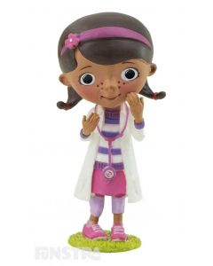 In costume, wearing her doctor's coat and stethoscope straight out of the toy hospital, Dottie McStuffins, is ready to fix your toys, dolls and stuffed animals for some fun imaginative play or makes a cute cake topper for your Doc McStuffins party.
