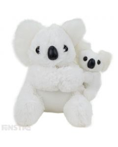 Baby koala clings onto mother's back in snowy white fluffy textiles. The koala with baby plush are a symbol of love and affection and these cuddly Aussie creatures are an adorable pair.