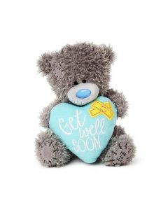 Tatty Teddy from Me to You is a gorgeous teddy bear that holds a love heart embellished with bandages and a 'Get Well Soon' message.