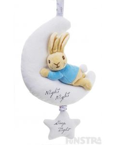 Peter Rabbit cuddles a moon. Pull down on the star to hear lullaby music.