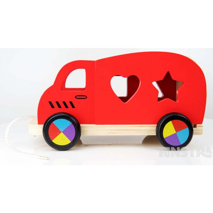 Children can learn shape as they place them through the openings on the wooden vehicle.