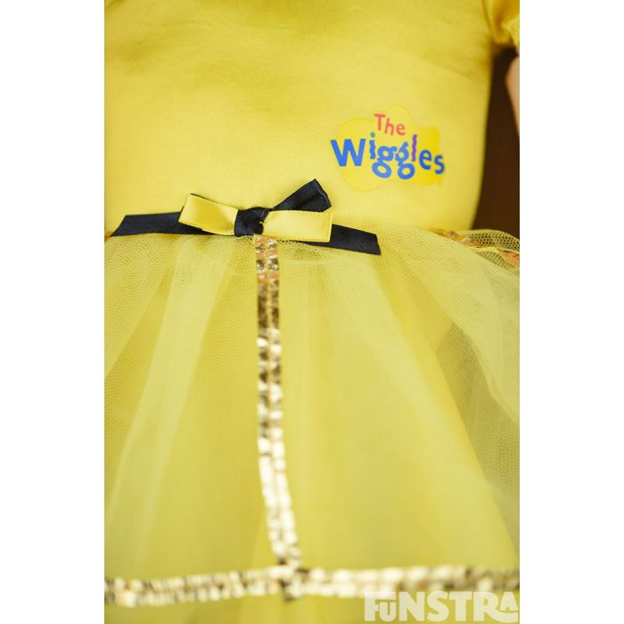 The dance with me doll wears a bowtiful ballerina costume, with a yellow tutu and yellow skivvy.