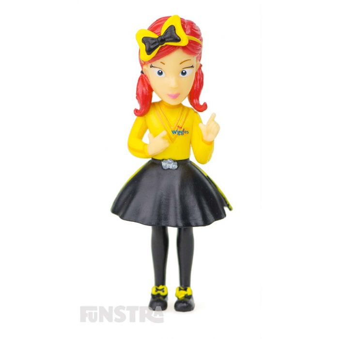 It's the yellow Wiggle figurine, Emma! Emma Wiggle loves sign language, wearing a bow in her red hair, playing the drums, dressing up in a tutu as a ballerina and dancing ballet.