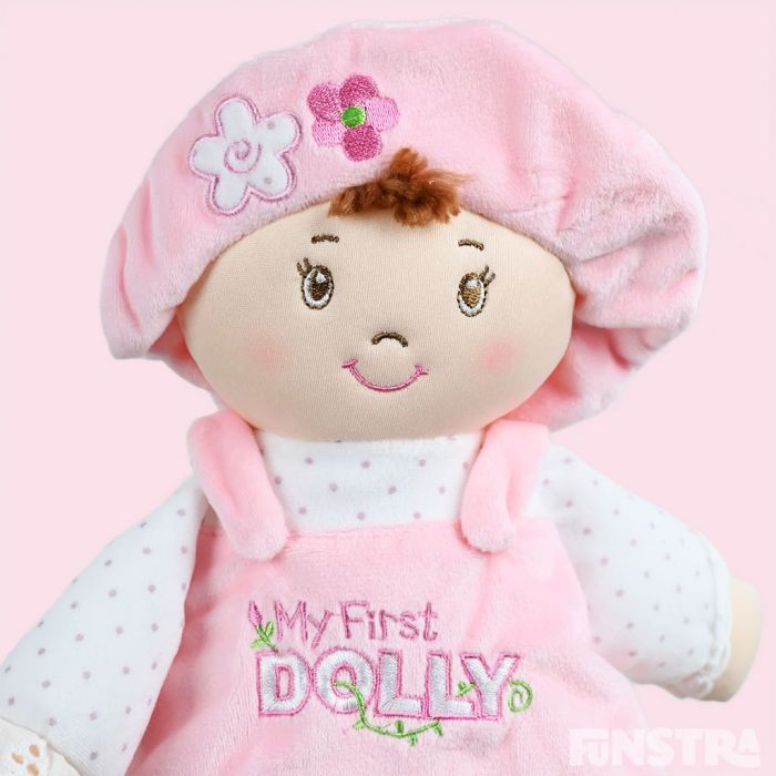 Baby's first dolly is dressed in pink and makes a wonderful gift for a newborn baby girl.