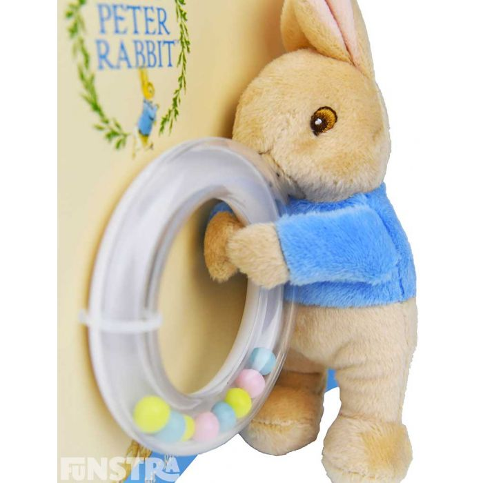 The mischievous Peter holds a ring rattle that will entertain little bunnies!