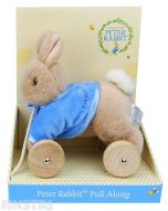 A Peter Rabbit stuffed toy is attached to a set of wheels with a rope attached for children to pull along and take their friend along with them.